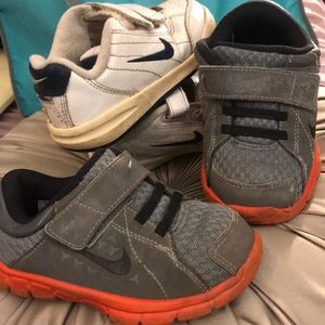 2 Nike sneakers and one pair of sandals